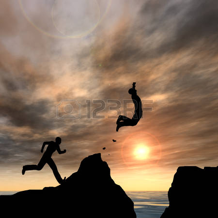 50315271-conceptual-business-man-silhouette-jumping-at-sunset-sky-background